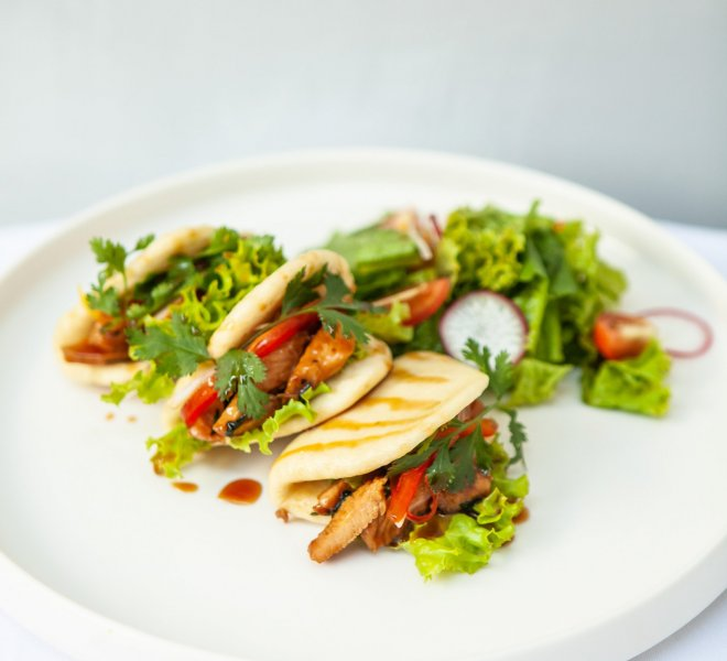 Little Chicken Bao Pao with salad tomato made as tacos