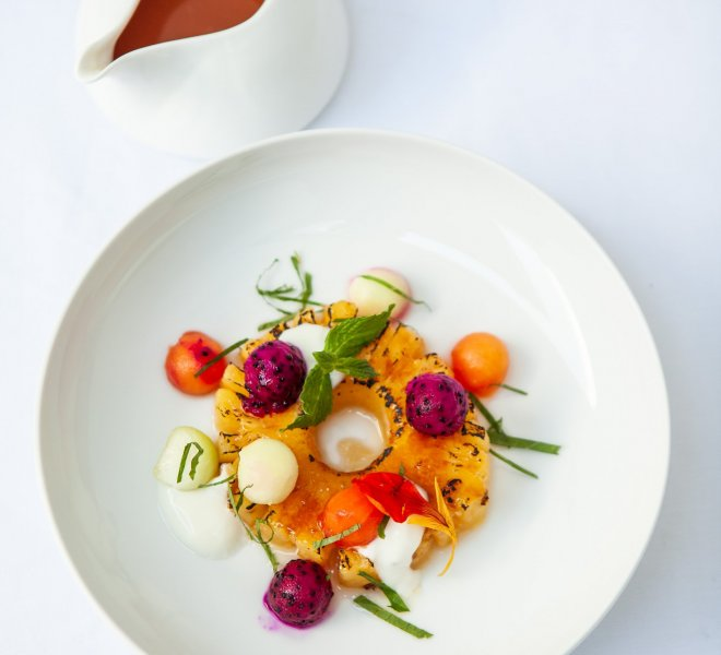 Plate with tropical poched fruits