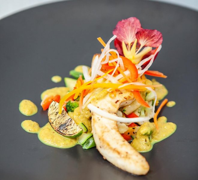 Grilled chicken decorated with flowers and vegetables